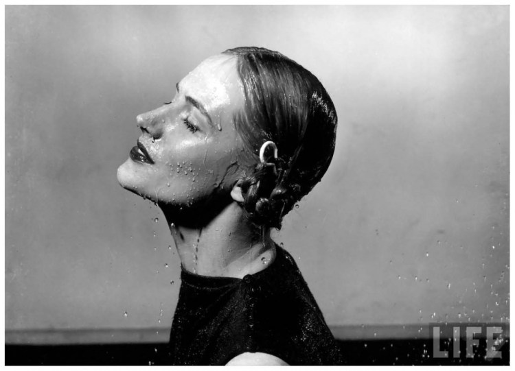 woman-appears-to-be-standing-under-shower-eyes-closed-hair-wet-water-dripping-from-face-1945-gjon-mili